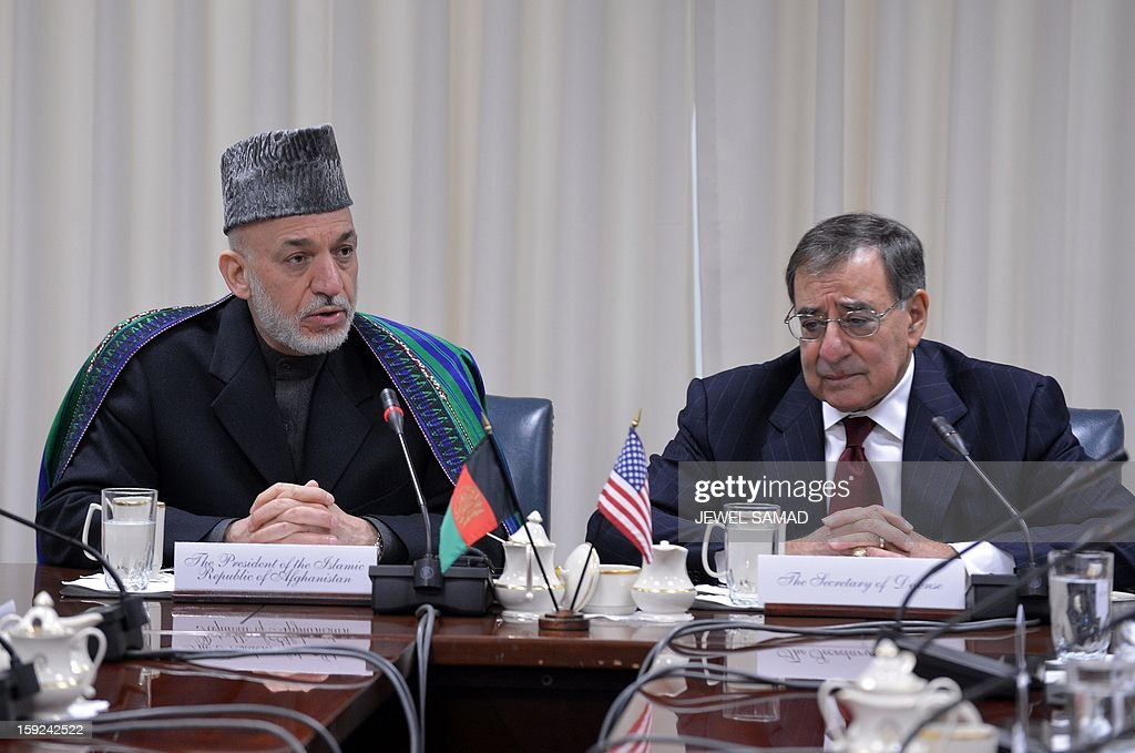 Afghan President Hamid Karzai (L) speaks as US Secretary of Defense Leon Panetta listens during their meeting at the Pentagon in Washington, DC, on January 10, 2013. AFP PHOTO/Jewel Samad