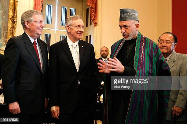 Afghan President Hamid Karzai speaks as US Senate Minority Leader Sen Mitch McConnell Senate Majority Leader Sen Harry Reid and Sen Daniel Inouye...