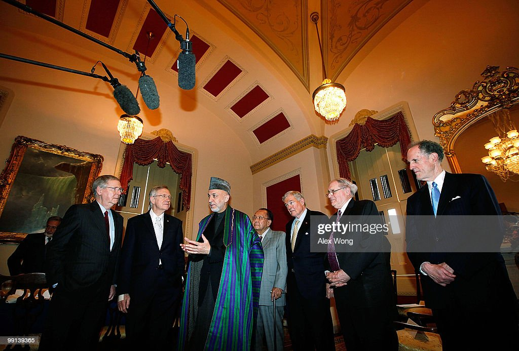 Afghan President <a gi-track='captionPersonalityLinkClicked' href=/galleries/search?phrase=Hamid+Karzai&family=editorial&specificpeople=121540 ng-click='$event.stopPropagation()'>Hamid Karzai</a> (3rd L) speaks as (L-R) U.S. Senate Minority Leader Sen. <a gi-track='captionPersonalityLinkClicked' href=/galleries/search?phrase=Mitch+McConnell&family=editorial&specificpeople=217985 ng-click='$event.stopPropagation()'>Mitch McConnell</a> (R-KY), Senate Majority Leader Sen. <a gi-track='captionPersonalityLinkClicked' href=/galleries/search?phrase=Harry+Reid+-+Politician&family=editorial&specificpeople=203136 ng-click='$event.stopPropagation()'>Harry Reid</a> (D-NV), Sen. Daniel Inouye (D-HI), Sen. Christopher Bond (R-MO), Sen. <a gi-track='captionPersonalityLinkClicked' href=/galleries/search?phrase=Carl+Levin&family=editorial&specificpeople=208878 ng-click='$event.stopPropagation()'>Carl Levin</a> (D-MI), and Sen. Edward Kaufman (D-DE) look on at the beginning of a meeting on Capitol Hill May 12, 2010 in Washington, DC. Karzai was meeting with members of the Senate on the Hill.