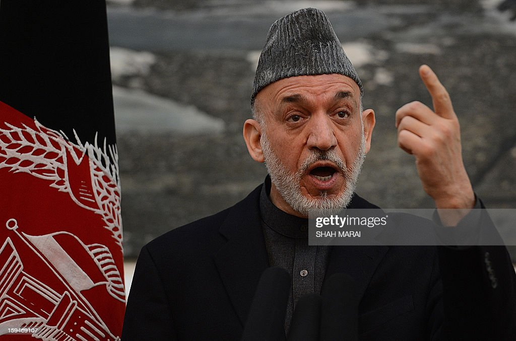 Afghan President Hamid Karzai speaks during a news conference at the Presidential Palace in Kabul on January 14, 2013. Afghan elders will decide on the key issue of whether US soldiers remaining in the country after 2014 will be granted immunity from prosecution, President Hamid Karzai said on 14 January. US President Barack Obama warned last week that no US troops would remain behind in Afghanistan after the withdrawal of NATO forces in 2014 unless they were granted immunity from prosecution in local courts. AFP PHOTO/ SHAH Marai
