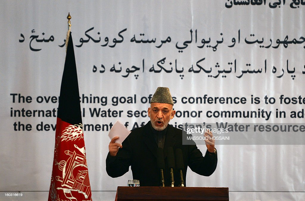 Afghan President Hamid Karzai speaks during the 3rd National Conference on Water Resources in Kabul on January 29, 2013. Karzai accused foreign countries of plotting against his war-weary nation's peace programme, saying all peace talks should take place under his administration. AFP PHOTO/ Massoud Hossaini