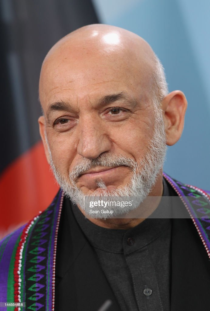 Afghan President Hamid Karzai speaks to the media after signing agreements with German Chancellor Angela Merkel on the future role of Germany in...