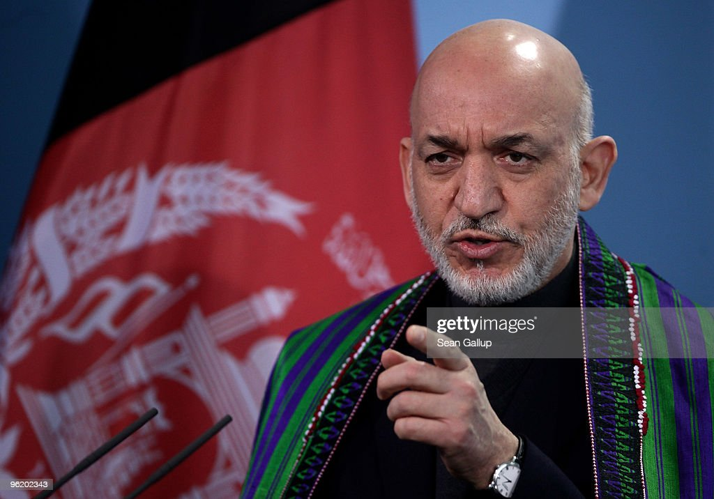 Afghan President Hamid Karzai speaks to the media after talks with German Chancellor Angela Merkel at the Chancellery on January 27 2010 in Berlin...