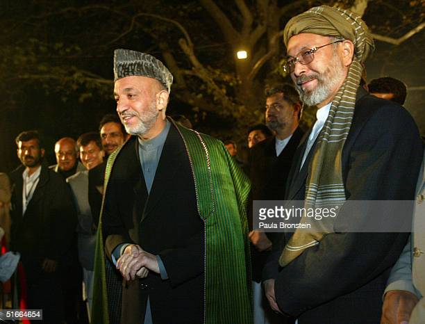 Afghan President Hamid Karzai talks to the news media with Vice President Karim Khalili after delivering his victory speech at the presidential...