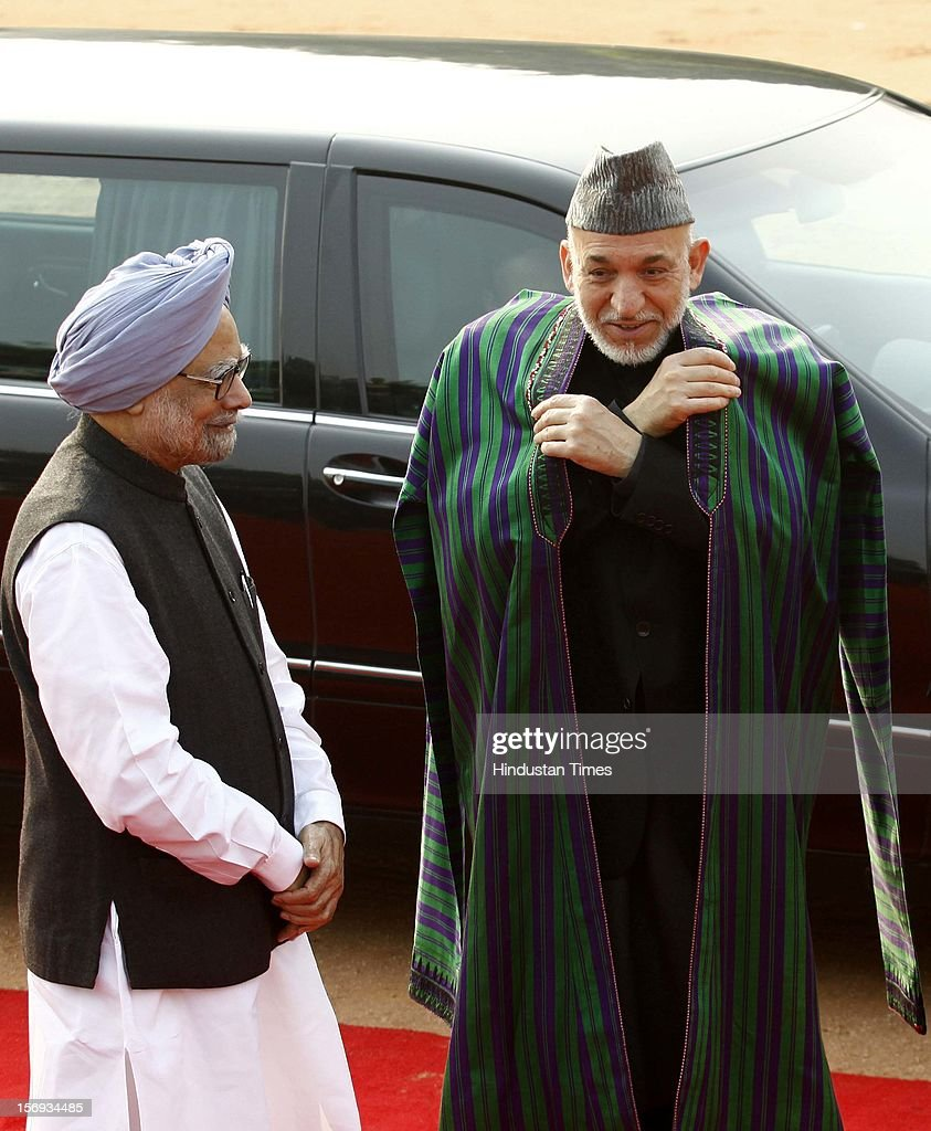 Afghan President Hamid Karzai with President Pranab Mukherjee and Prime Minister Manmohan Singh during his ceremonial reception at the Rashtrapati Bhawans on November 12, 2012 in New Delhi, India.
