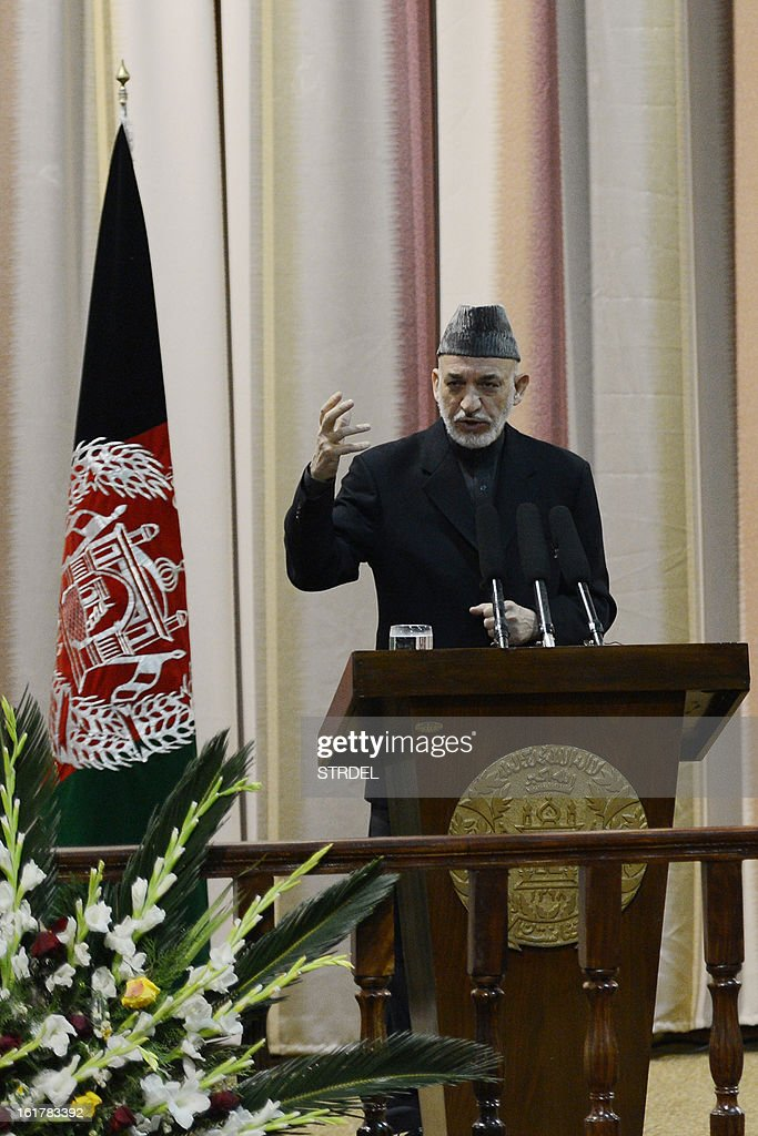 Afghan President Hamir Karzai addresses Afghan National Army officers during a conference at the National Miltary Academy in Kabul on February 16, 2013. Afghanistan has committed to taking full responsibility for its own security after US forces leave, and the White House said Afghan security forces now count 352,000 troops, thanks to a broad NATO training effort.