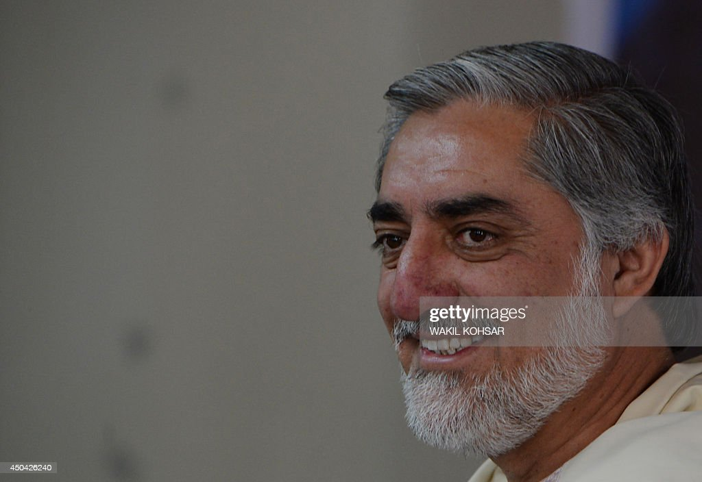 Afghan presidential candidate <a gi-track='captionPersonalityLinkClicked' href=/galleries/search?phrase=Abdullah+Abdullah&family=editorial&specificpeople=695346 ng-click='$event.stopPropagation()'>Abdullah Abdullah</a> arrives at a gathering on the last day of campaigning, at his residence in Kabul on June 11, 2014. Afghanistan's election will go to a run-off vote between former foreign minister <a gi-track='captionPersonalityLinkClicked' href=/galleries/search?phrase=Abdullah+Abdullah&family=editorial&specificpeople=695346 ng-click='$event.stopPropagation()'>Abdullah Abdullah</a> and ex-World Bank economist Ashraf Ghani, results confirmed, as the country enters a new era without NATO combat troops. The head-to-head election, scheduled for June 14, will choose a successor to President Hamid Karzai in Afghanistan's first democratic transfer of power. AFP PHOTO/WAKIL Kohsar