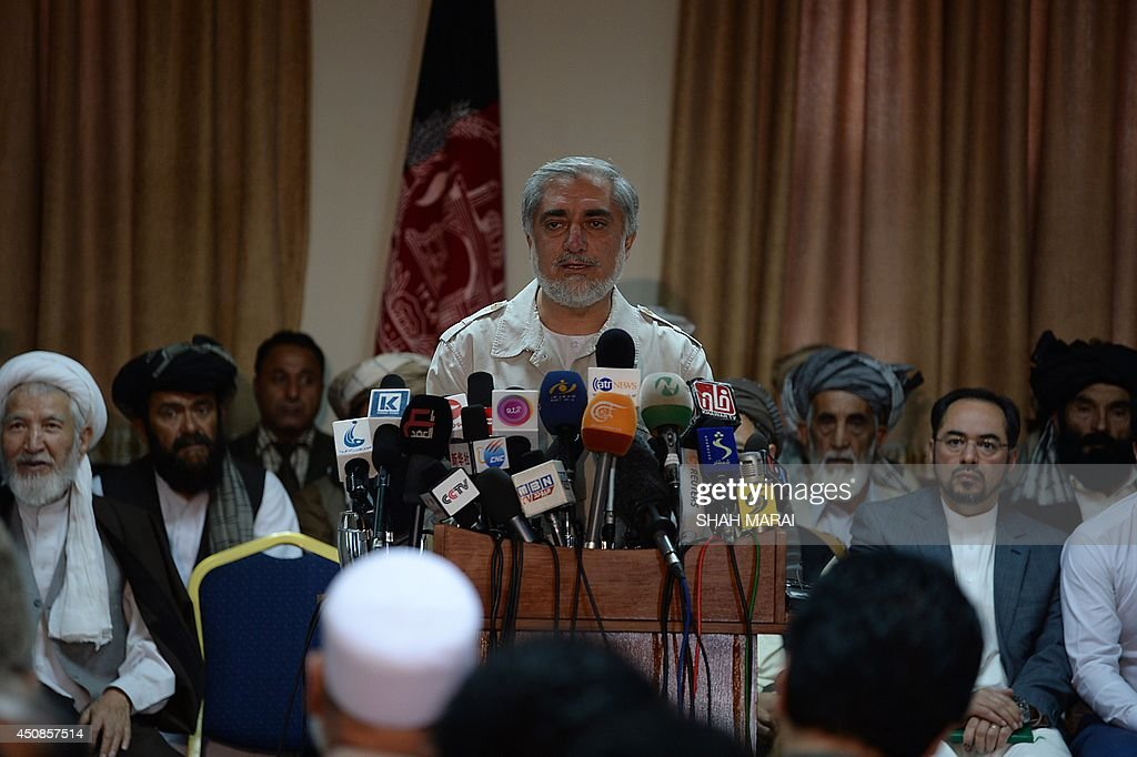 Afghan presidential candidate Abdullah Abdullah gestures as he speaks during a press conference at his residence in Kabul on June 19, 2014. Afghanistan's election crisis deepened on June 19 when presidential candidate Abdullah Abdullah said he would reject the result because his claims of massive fraud have failed to stop the vote count. 'From now on, any action from the electoral commissions will be illegal and the outcomes not acceptable for us,' he said. AFP PHOTO/SHAH Marai