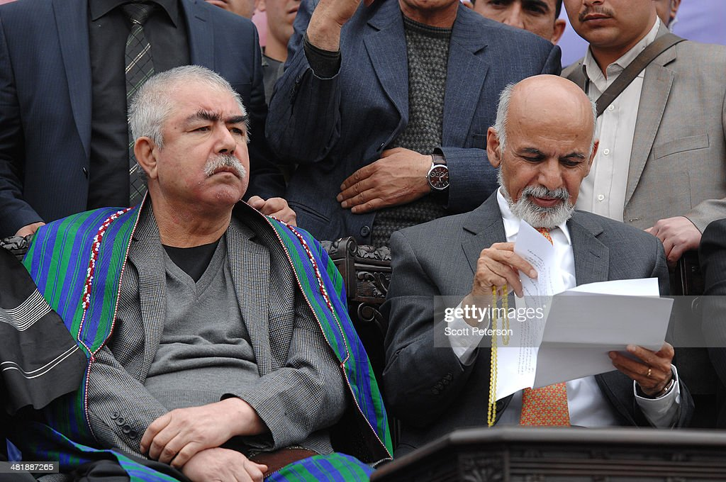 Afghan Presidential Candidate Ashraf Ghani Ahmadzai (right) and his vice presidential running mate Gen. Rashid Dostum hold a rally for thousands of supporters at the Ghazi stadium on April 1, 2014 in Kabul, Afghanistan. Mr. Ghani is a frontrunner in the April 5 vote to succeed President Hamid Karzai, in an election that is seen as a test of stability that will ensure continued Western donor aid for a nation torn by a Taliban insurgency. The Ghazi stadium is known as the site of amputations and executions during Taliban rule in the late 1990s.