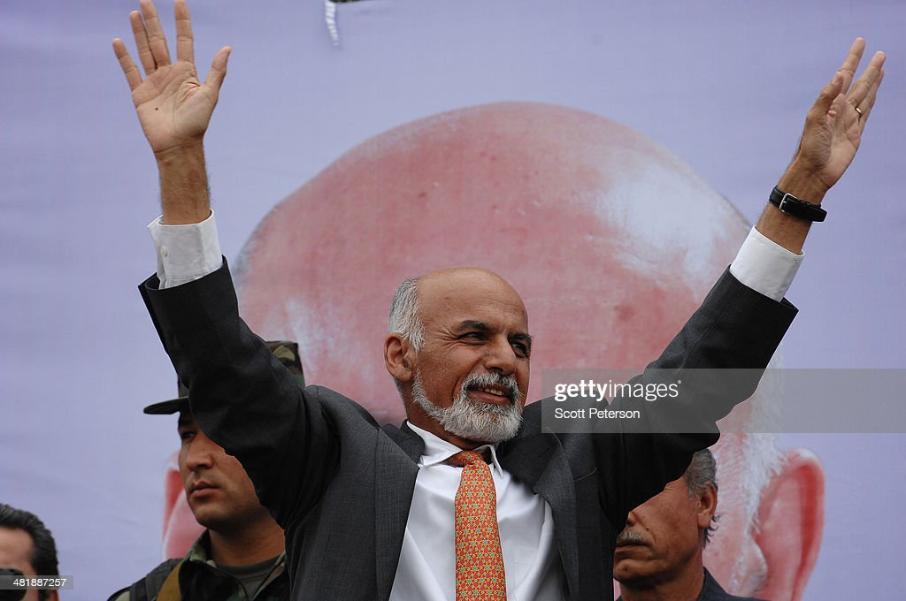 Afghan Presidential Candidate Ashraf Ghani Ahmadzai hold up his arms at a rally for thousands of supporters at the Ghazi stadium on April 1, 2014 in Kabul, Afghanistan. Mr. Ghani is a frontrunner in the April 5 vote to succeed President Hamid Karzai, in an election that is seen as a test of stability that will ensure continued Western donor aid for a nation torn by a Taliban insurgency. The Ghazi stadium is known as the site of amputations and executions during Taliban rule in the late 1990s.