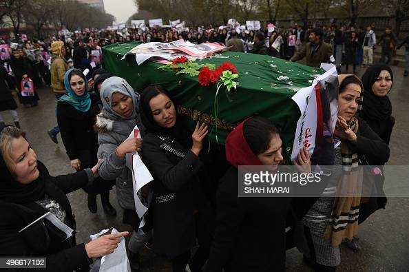 Afghan protesters carry a coffin containing a decapitated body of one of seven Shiite Muslim Hazaras including four men two women and one child...