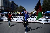 Afghan protesters shout antigovernment slogans during a demonstration in the city of Kabul on July 23 2016 Thousands of minority Shiite Hazaras...