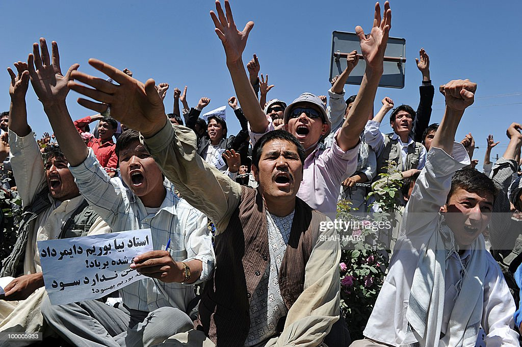 Afghan protestors shout slogans during a demonstration in Kabul on May 20, 2010. Thousands of ethnic Hazaras have marched through the Afghan capital in a tense protest over a dispute with nomads about land and grazing rights. AFP PHOTO/SHAH Marai