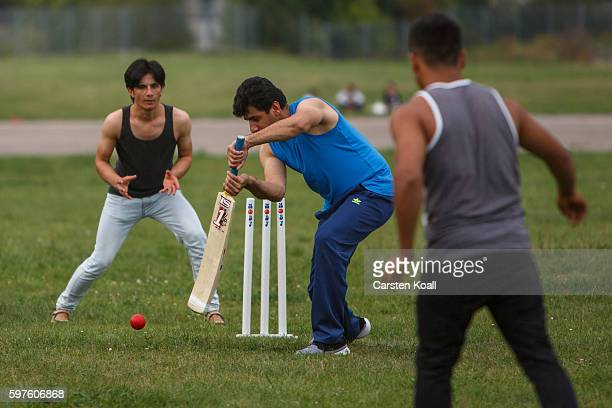 Afghan refugee Abdul Qudeer Khan plays cricket together with other refugees on the Tempelhofer Feld on August 28 2016 in Berlin Germany Many migrants...