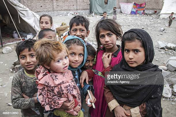 Afghan refugee children who have recently returned from the refugee camps in Pakistan seen at a temporary shelters in Jalalabad on March 16 2015