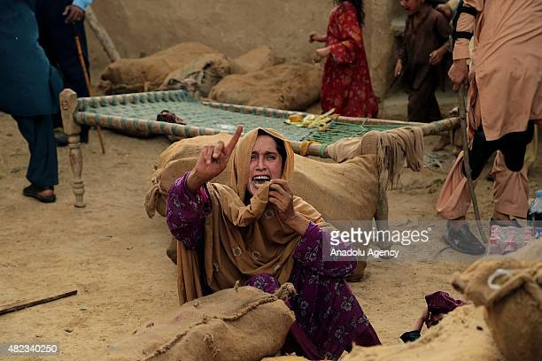 Afghan refugee woman cries during the Pakistani officials' attempt to demolish the refugee village to conduct Islamabad's High Court's decision at a...