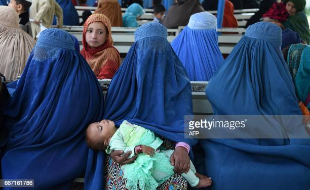 Afghan refugee women wait for their registration at the United Nations High Commissioner for Refugees repatriation centre on the outskirts of...