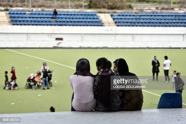 Afghan refugees attend the celebrations of Nauroz 'New day' the traditional Afghan New Year's Day on March 21 2017 at the Hockey refugee camp...