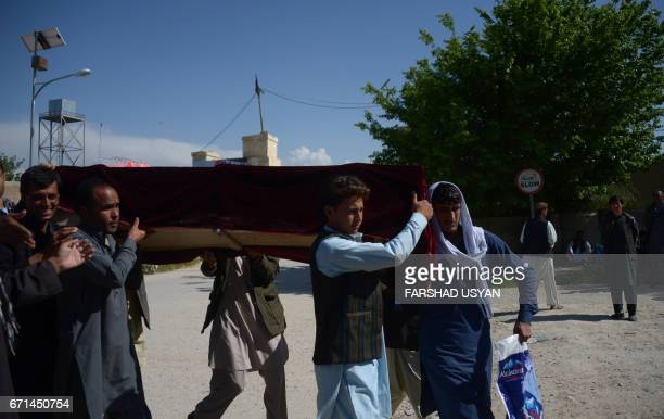 Afghan relatives carry the coffin of a Afghan National army soldier killed in a Taliban attack on an army base in the Dihdadi district of Balkh...