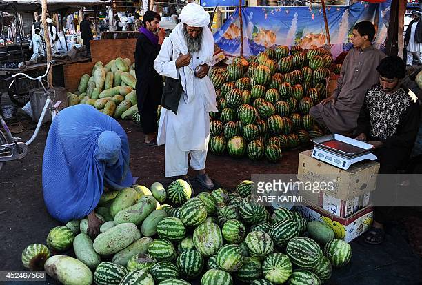 Afghan residents buy watermelons at a busy market during the Islamic holy month of Ramadan in Herat province on July 20 2014 Across the Muslim world...