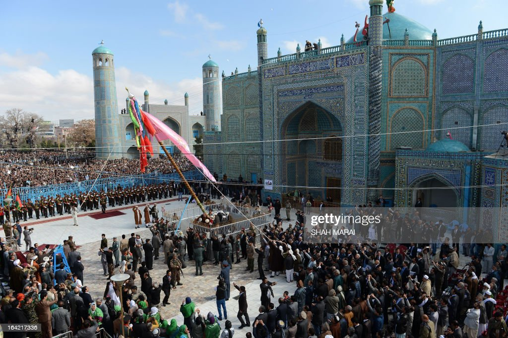 Afghan revellers raise the holy mace during Noruz festivities in Mazar-i Sharif, the centre of the Afghan new year celebrations, on March 21, 2013. Nowruz, one of the biggest festivals of the war-scarred nation, marks the first day of spring and the beginning of the year in the Persian calendar. Nowruz is calculated according to a solar calendar, this coming year marking 1392. AFP PHOTO/ SHAH Marai