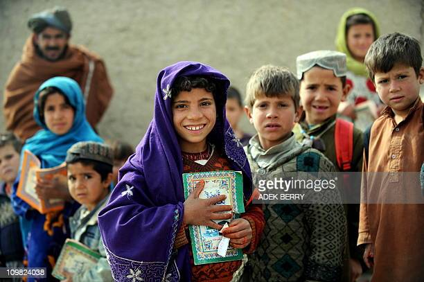 Afghan school girls stand among boys during a class as US Marines of the 2nd Batallion 1st Marines Fox Company on a joint patrol with Afghanistan...