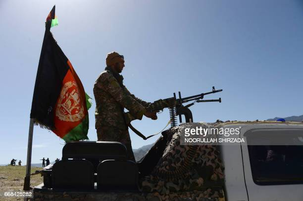 Afghan security force personnel take part in an ongoing operation against an Islamic State militant stronghold in Achin district of Nangarhar eastern...