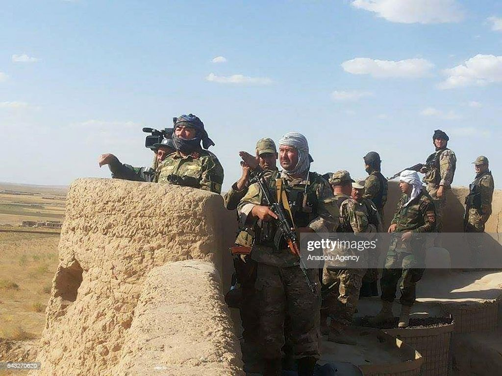 Afghan security forces are seen after an operation against Taliban in the Faryab province of Afghanistan on June 27, 2016. It has been said that 10 Taliban militants were killed in the operation.