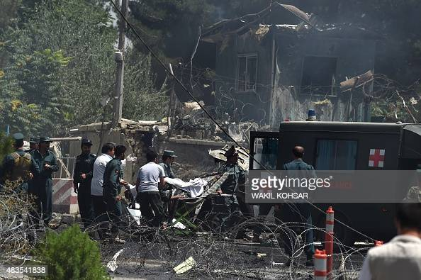 Afghan security forces carry a victim into a ambulance at the site of a huge blast near the entrance of the international airport in Kabul on August...