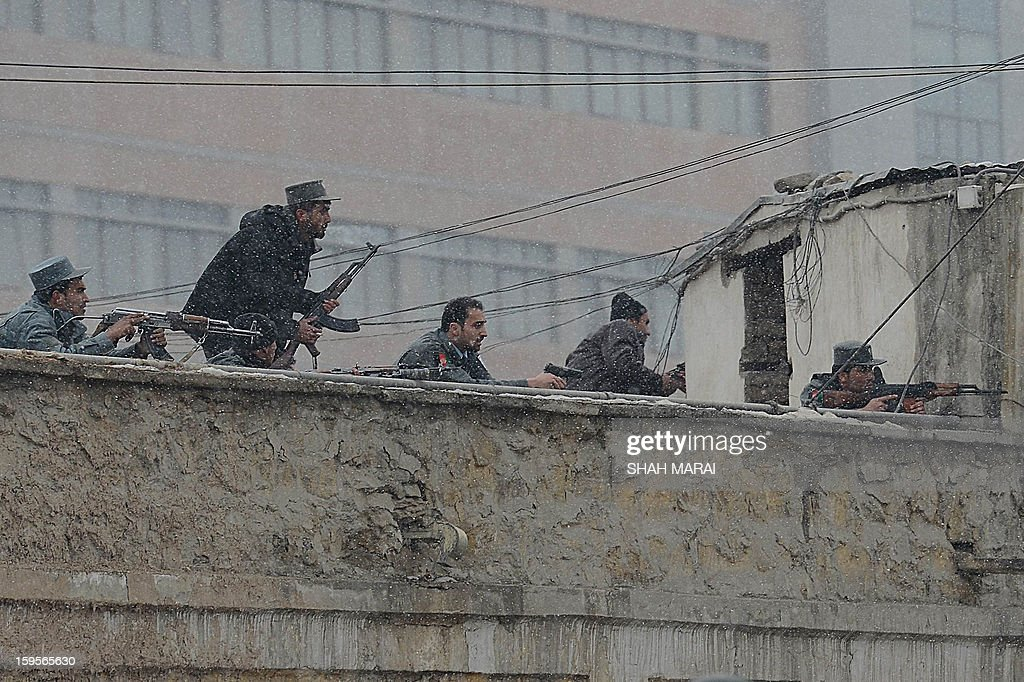 Afghan security forces exchange fire with militants at the site of a suicide attack near the Afghan intelligence agency headquarters in Kabul on January 16, 2013. A squad of suicide bombers attacked the national intelligence agency headquarters in heavily-fortified central Kabul on January 16, killing at least two guards and wounding dozens of civilians, officials said. AFP PHOTO/ SHAH Marai
