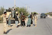 Afghan security forces gather at the roadside a day after Taliban insurgents overran the strategic northern city of Kunduz on September 29 2015...
