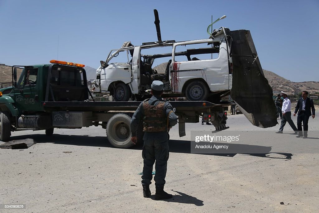 Afghan security forces inspect the area of suicide bomb attack, targeting a bus carrying court workers, in Kabul, Afghanistan on 25 May 2016. 10 people were killed and 4 people were wounded in a suicide bomb attack.