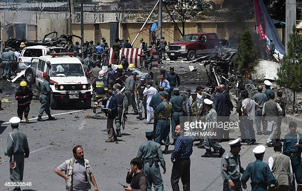 Afghan security forces inspect the site of a huge blast near the entrance of Kabul's international airport in Kabul on August 10 2015 A huge blast...