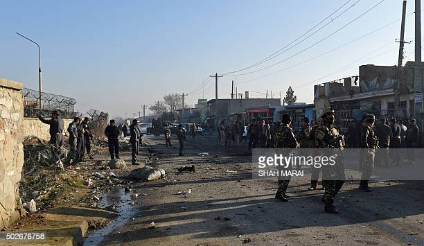 Afghan security forces inspect the site of a suicide car bomb near international airport in Kabul on December 28 2015 A Taliban bomber has detonated...