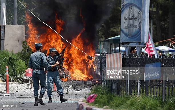 Afghan security forces keep watch at the site of a huge blast near the entrance of Kabul's international airport in Kabul on August 10 2015 A huge...