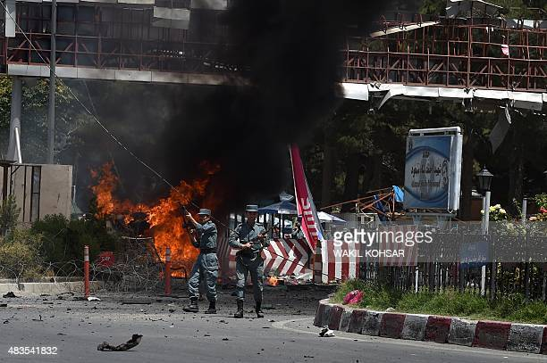 Afghan security forces keep watch at the site of a huge blast near the entrance of the international airport in Kabul on August 10 2015 At least five...