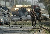 Afghan security forces keep watch at the site of a suicide attack in Kabul on September 16 2014 A large blast ripped through central Kabul on...