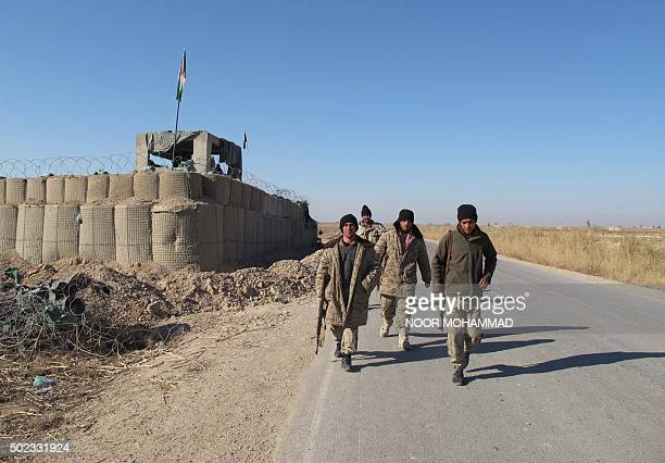 Afghan security forces patrol near their base in the Marjah district of Helmand Province on December 23 2015 Military planes have dropped food and...