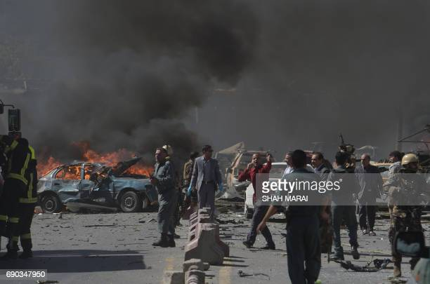 Afghan security forces personnel are seen at the site of a car bomb attack in Kabul on May 31 2017 At least 40 people were killed or wounded on May...