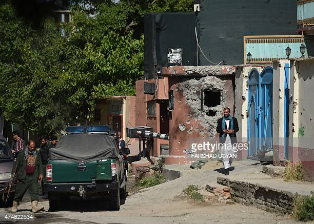 Afghan security forces stand at the gates of the Heetal Hotel in Kabul on May 27 2015 the morning after gunfire and explosions rang out in a...