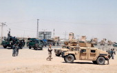 Afghan security forces stand at the site of a suicide attack in Kandahar on July 9 2014 22 militants were shot dead after launching an attack on...
