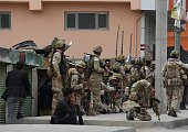 Afghan security forces take position during attack at the site of an attack in front of Parliament building in Kabul on June 22 2015 Taliban...
