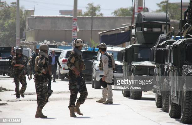 Afghan security forces take security measures after militants carried out a rocket attack at Kabul International Airport in Kabul Afghanistan on...