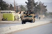 Afghan Security forces take security measures following the clashes between Taliban militants after an armed assault at a border police post in...