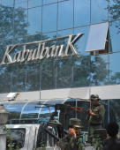 Afghan security guards keep watch outside the main branch of the Kabul Bank in Kabul on September 5 2010 Branches of Afghanistan's biggest private...