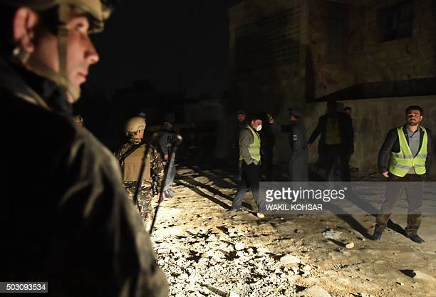 Afghan security officials arrive at the site of a suicide car bomb attack at a French restaurant Le Jardin in Kabul on January 1 2016 A Taliban...