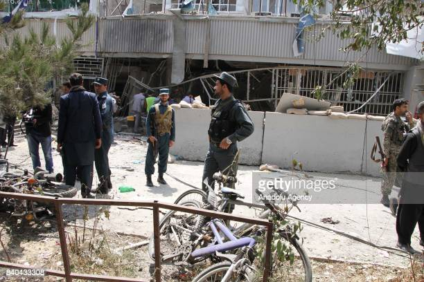 Afghan security officials inspect the building of Kabul bank after a suicide bomb attack in Kabul Afghanistan on August 29 2017 At least 5 people...