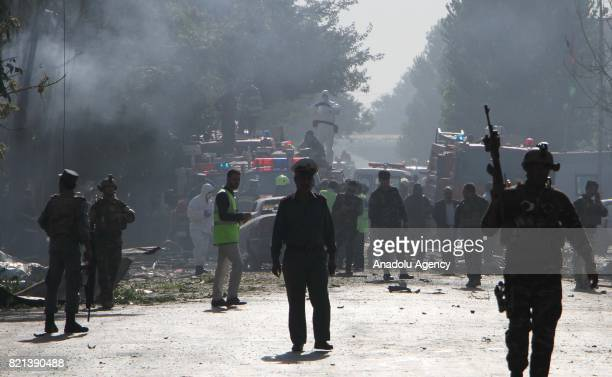 Afghan security officials inspect the Suicide attack site in Kabul Afghanistan on July 24 2017