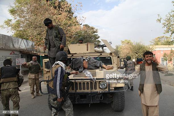 Afghan security officials patrol in the city center following an operation aimed at retaking Kunduz from the Taliban on October 03 2015 in Kunduz...