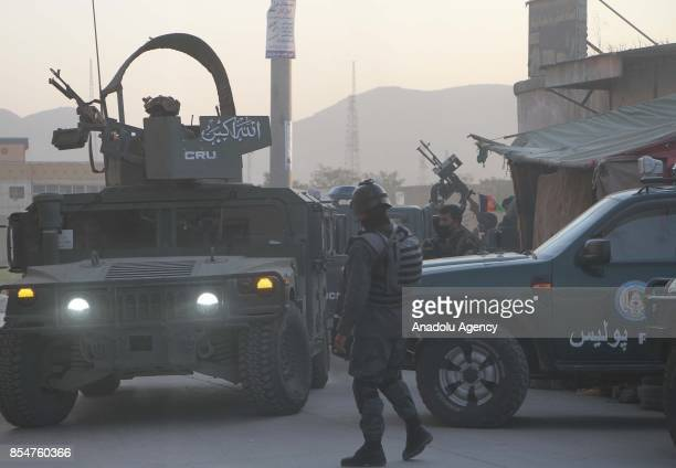 Afghan security officials take position after suicide bomber attacked on Kabul International Airport in Kabul Afghanistan on September 27 2017 An...